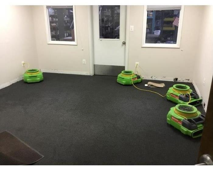air movers set up in an office